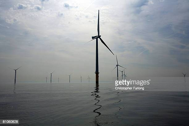 Turbines of the new Burbo Bank off shore wind farm stand in a calm sea in the mouth of the River Mersey on May 12 2008 in Liverpool England The Burbo...