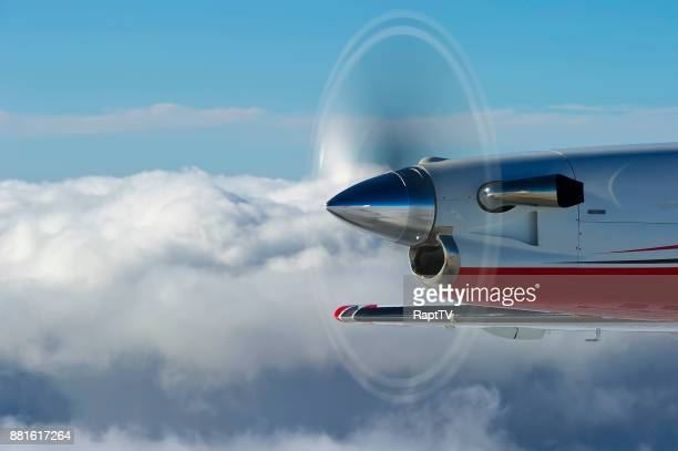 A Turbo Prop Airplane Propeller Spinning Over the Clouds.