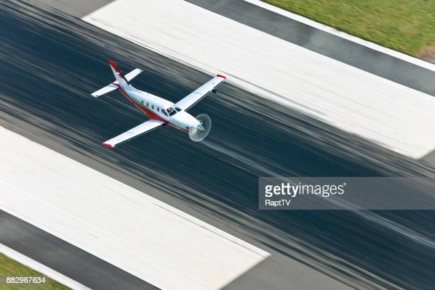 A Turbo Propeller Airplane Flying From Runway.
