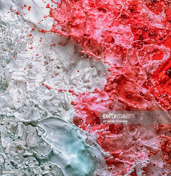 turbulent liquid, shades of white, red and blue - confrontation stock pictures, royalty-free photos & images