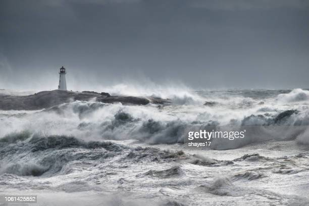 turbulent ocean lighthouse - meteorology stock pictures, royalty-free photos & images