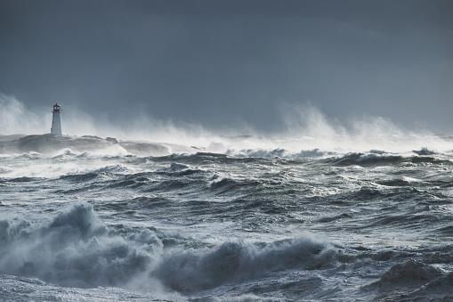 Turbulent ocean lighthouse 918749116