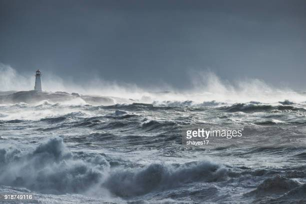 turbulent ocean lighthouse - storm stock pictures, royalty-free photos & images