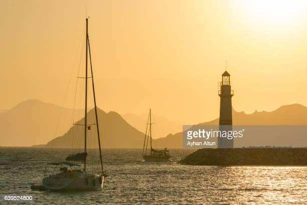 Turgutreis Marina Lighthouse at sunset, Bodrum, Turkey