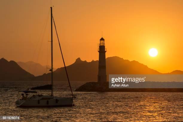 Turgutreis Marina Lighthouse at sunset in Bodrum, Turkey