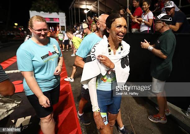 Turia Pitt of Australia reacts to finishing the 2016 IRONMAN World Championship triathlon on October 8 2016 in Kailua Kona Hawaii