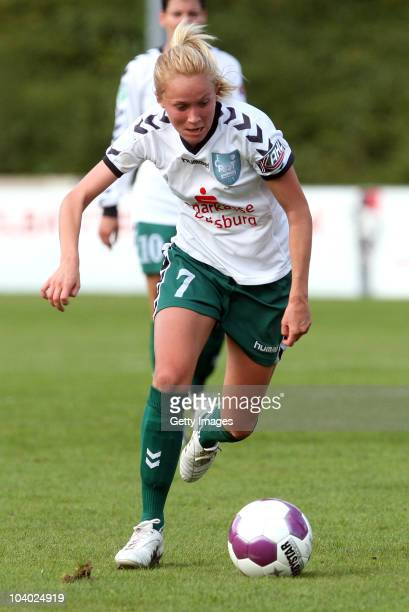 Turid Knaak of Duisburg runs with the ball during the Women's bundesliga match between FCR Duisburg and FFC Frankfurt at the PCCStadium on September...