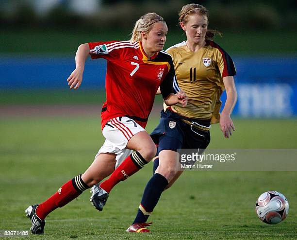 Turid Knaak of Germany battles with Sam Mewis during the FIFA U17 Women`s World Cup Semi Final match between Germany and the USA at QE II Stadium on...