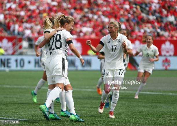 Turid Knaak of Germany celebrates a goal with Lena Petermann and Verena Faibt during the second half of an International Friendly match against...