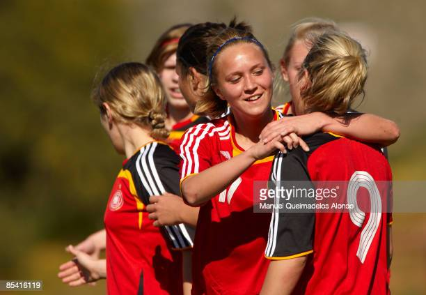 Turid Knaak of Germany gets a hugs from her team mate Svenja Huth during the U19 women international friendly match between USA and Germany on March...
