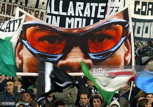 Turin fans hold a banner of Juventus midfielder Dutch Edgar Davids before the Italian first league match AS Roma-Juventus Turin 01 December 2002 at...