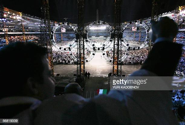 A supporter cheers as members of the delegation of Italy the host nation pass by during the opening ceremonies of the 2006 Winter Olympics 10...
