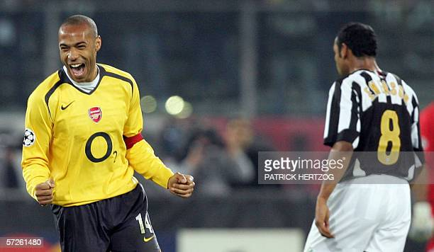 Arsenal's forward Thierry Henry of France celebrates as Juventus' midfielder Emerson Da Rosa of Brazil reacts at the end of their Champions League...
