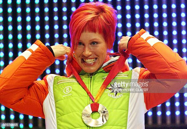 Biathlon Women's 12.5km Mass Start silver medallist Kati Wilhelm of Germany poses on the podium during a 2006 Winter Olympics medals' ceremony in...