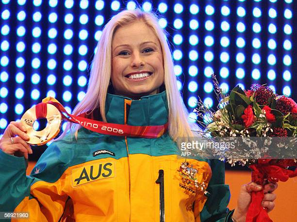 Bronze medallist Alisa Camplin of Australia shows her medal on the podium 23 February 2006 during the Ladies' Aerials Freestyle skiing medals...