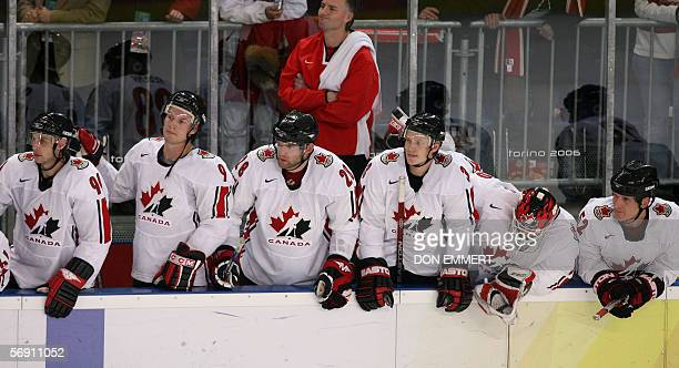 Canada's bench including goalie Martin Brodeur watches toward the end of the game during the 2006 Winter Olympics ice hockey men's quarterfinals...