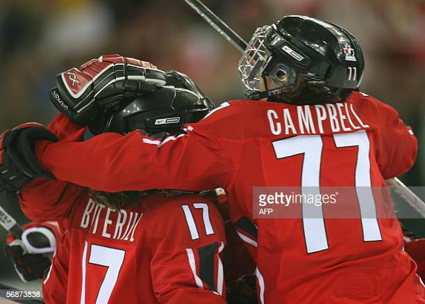 Canadian Cassie Campbell jumps on teammates after scoring a goal during the ice hockey women's semifinal Canada vs Finland at the 2006 Winter...