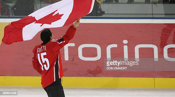 Canadian Danielle Goyette skates with a Canadian flag at the end of the ice hockey women's gold medal game Sweden vs Canada at the 2006 Winter...