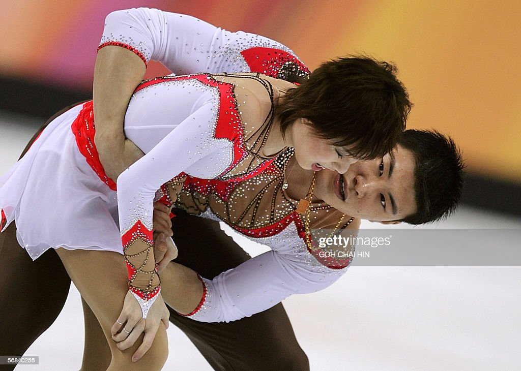 China's Zhang Hao helps his partner Zhang Dan after she fell down during the Pairs Free Skating program of the Figure skating competition at the 2006 Winter Olympics games, 13 February 2006 at the Palavela ice rink in Turin. They won the silver medal and Russian pair Tatiana Totmianina and Maxim Marinin won the competition.