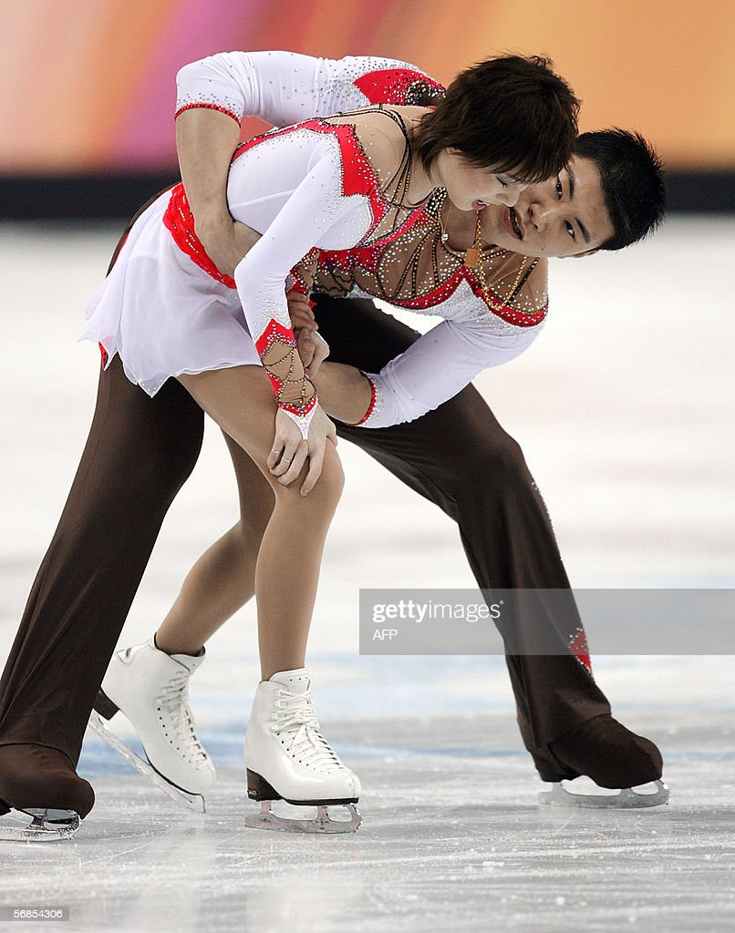 Chinese skater Zhang Dan is helped off the ice after she crashed into the boards edging the Palavela arena while attempting to create history by landing an unprecedented throw quad salchow during their performance in the Pairs Free Skating program at the 2006 Winter Olympics, 13 February 2006 at the Palavela in Turin. After her fall, Zhang Dan was helped off the ice by her partner. After several minutes of confusion, during which the pair consulted their coaches, Zhang Dan and Zhang Hao decided to continue which gave them a personal best score to hold their second place from the short programme. China's Zhang Dan and Zhang Hao's fresh start after a bad fall during the opening of the figure skating free skate final at the Palavela on Monday night was ratified 14 February 2006 by the International Skating Union (ISU). The pair is now targetting world domination after their courageous free programme gave their country a first ever Olympic Games figure skating silver.