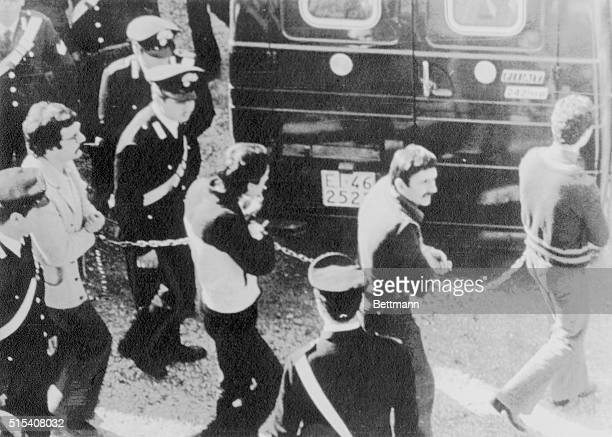 Four members of the Red Brigades urban guerrillas chained together and escorted by Carabinieri national police leaving Turin courtroom March 10 at...