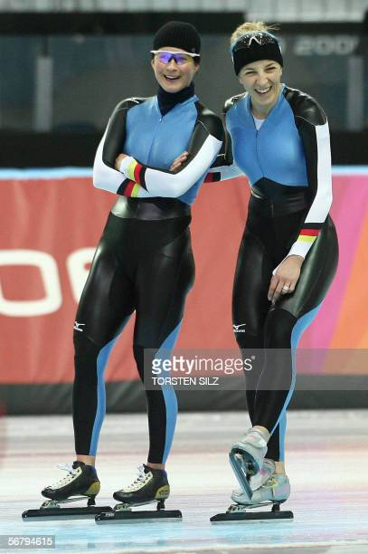 German speed skating medal hopes Claudia Pechstein and Anni Friesinger share a laugh during a training session 09 February 2006 in Turin, on the eve...
