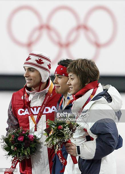 Gold medalist US Apollo Anton Ohno Canada's FrancoisLouis Tremblay and bronze medalist South Korea's Ahn HyunSoo pose on the podium of the men's 500m...