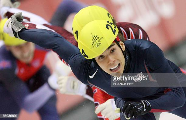 Gold medalist US Apollo Ohno performs during the men's 500m race of the short track competition at the 2006 Winter Olympics 25 February 2006 at the...