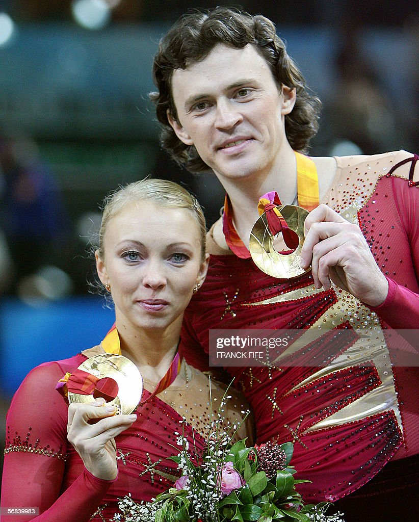 Gold medalists Russian pair Tatiana Totmianina and Maxim Marinin pose with their gold medals after winning the Pairs Free Skating program during the Figure skating competition at the 2006 Winter Olympics, 13 February 2006 at the Palavela in Turin. China's Zhang Dan and Zhang Hao won the silver medals with the bronze going to their compatriots Shen Xue and Hongbo Zhao.