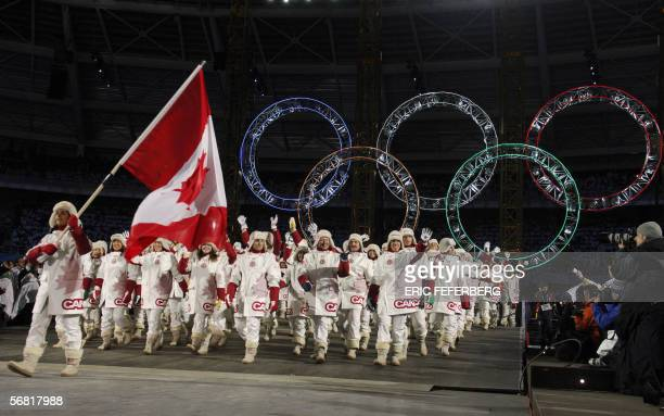 Ice hockey athlete Danielle Goyette is the flag bearer for the Canadian delegation during the opening ceremonies of the 2006 Winter Olympics 10...
