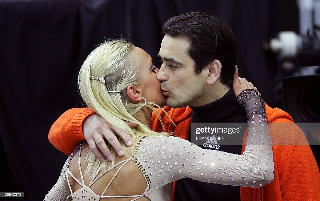 Ingo Steuer, coach of the German pair Aliona Savchenko and Robin Szolkowy kisses Savchenko after the Pairs Free Skating program during the Figure skating competition at the 2006 Winter Olympics, 13 February 2006 at the Palavela in Turin.