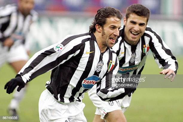Juventus' forward Alessandro Del Piero is congratulated by his teammate Adrian Mutu after scoring a goal against Udinese during their serie A...