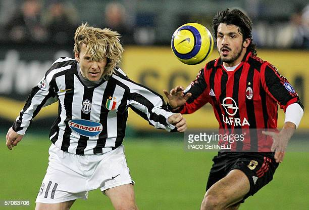 Juventus's Czech midfielder Pavel Nedved and AC Milan's Italian midfileder Gennaro Gattuso eye the ball during their Serie A football match 12 March...