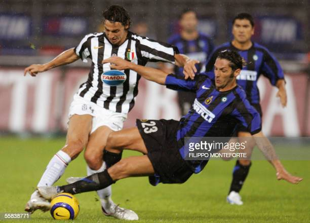 Juventus's forward Zlatan Ibrahimovic of Sweden is roughtly tackled by Inter Milan's Marco Materazzi during their Serie A football match in Turin's...