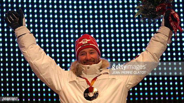 Norway's SuperG gold medalist Kjetil Andre Aamodt poses on the podium during a 2006 Winter Olympics medals ceremony in Turin 18 February 2006 Aamodt...