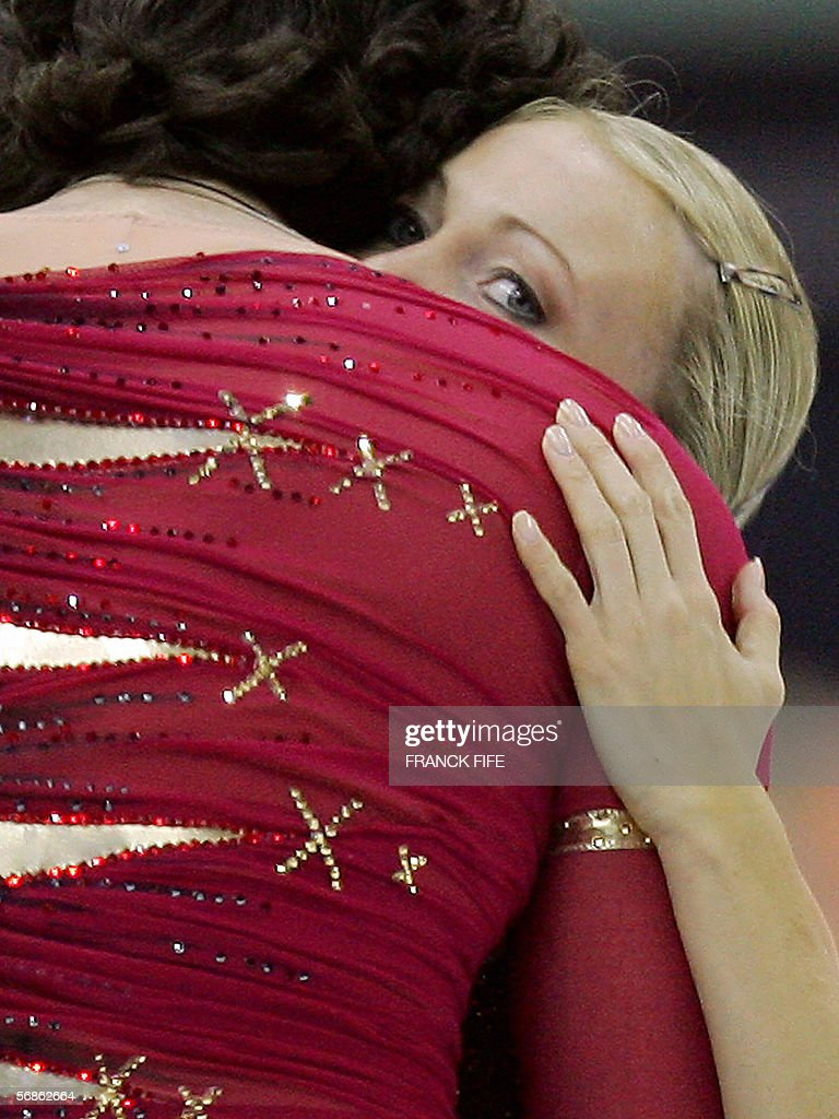 Russian pair Tatiana Totmianina and Maxim Marinin react after the Pairs Free Skating program of the Figure skating competition at the 2006 Winter Olympics games, 13 February 2006 at the Palavela ice rink in Turin. They won the gold medal.