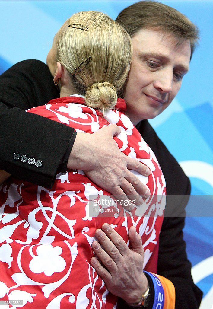Russian pair Tatiana Totmianina is congratulated by her coach Oleg Vasiliev after her performance with Maxim Marinin in the Pairs Free Skating program during the Figure skating competition at the 2006 Winter Olympics, 13 February 2006 at the Palavela in Turin. Tatiana Totmianina and Maxim Marinin pulled out the best free skate of their career to claim the pairs figure skating gold.