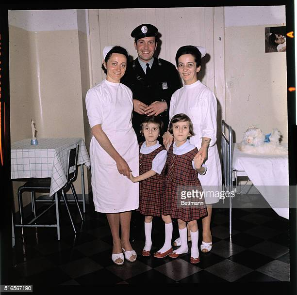Turin Italy Santina and Giuseppina Foglia separated siamese twins with nurses and the 'cop' who looks after them May 13