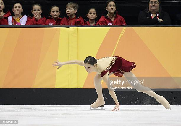 Silver medalist US Sasha Cohen falls during her ladies free skating program of the Figure skating competition at the 2006 Winter Olympics 23 February...