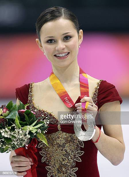 Silver medalist US Sasha Cohen poses on the podium after the ladies free skating program of the Figure skating competition at the 2006 Winter...