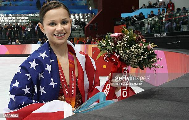 Silver medalist US Sasha Cohen poses with her national flag after the ladies free skating program of the Figure skating competition at the 2006...
