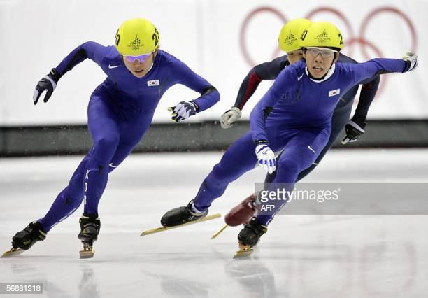 South Korea's Ahn HyunSoo his compatriot Lee HoSuk and US Apollo Ohno perform during the Men's 1000 m final of the short track competition at the...