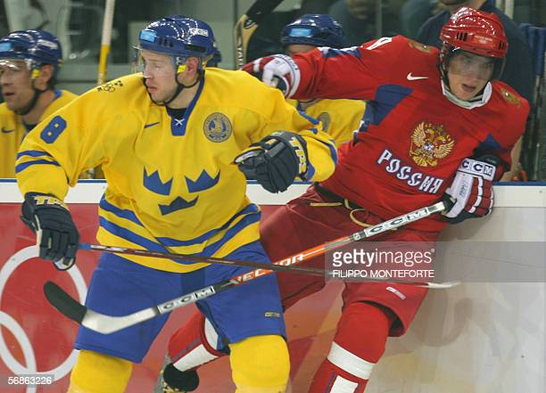 Sxeden's Christian Backman fights for the puck with Russian Alexander Ovechkin during the ice hockey men's preliminary round SwedenRussia at the 2006...