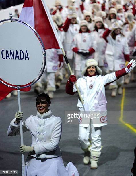 The Canadian delegation with ice hockey athlete Danielle Goyette as the flag bearer tours the stadium during the opening ceremonies of the 2006...