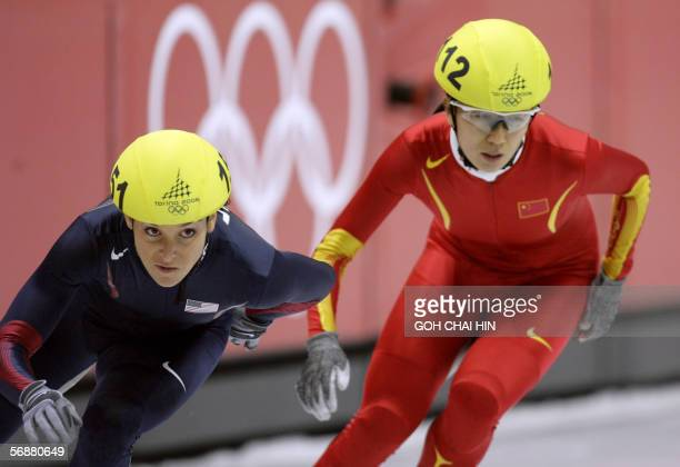 US Allison Baver and China's Yang Yang skate in the Ladies' 1500 m semifinal during the short track competition at the 2006 Winter Olympics 18...