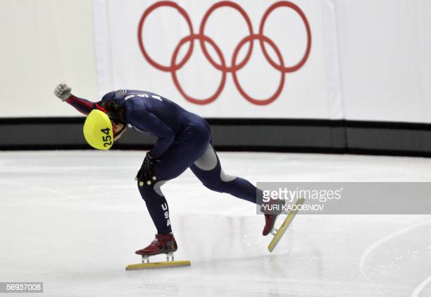 US Apollo Ohno celebrates after winning the gold medal of the men's 500m race during the short track competition at the 2006 Winter Olympics 25...