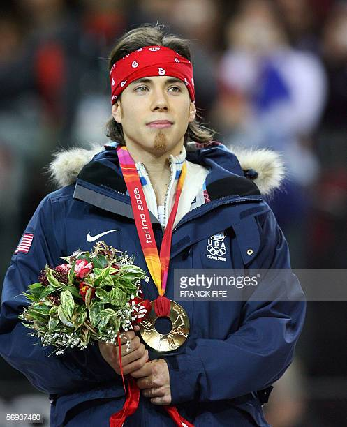 US Apollo Ohno poses on the podium after winning the gold medal of the men's 500m race during the short track competition at the 2006 Winter Olympics...
