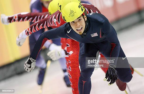 US Apollo Ohno skatea ahead of Canada's Francois Louis Tremblay to win the gold medal in the men's 500m final during the short track competition at...