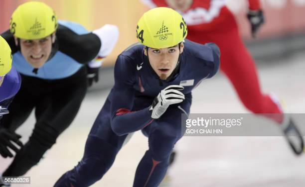 US Apollo Ohno skates in the Men's 1000 m quarterfinal during the short track competition at the 2006 Winter Olympics 18 February 2006 at the...