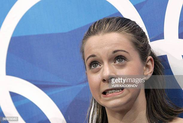 US Emily Hughes reacts in the kiss and cry zone after her performance in the ladies free skating program of the Figure skating competition at the...